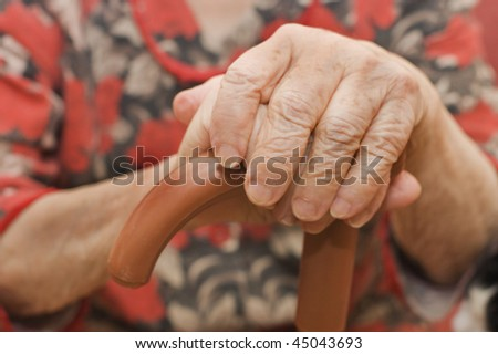 Hands of the old woman - stock photo