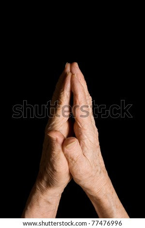 Hands of the old woman on a black background - stock photo