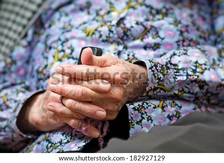 Hands of the old woman - praying - stock photo
