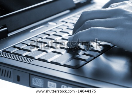 Hands of the woman on the keyboard of a laptop - stock photo