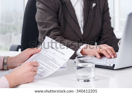 Hands of the woman signature document at notary public office - stock photo