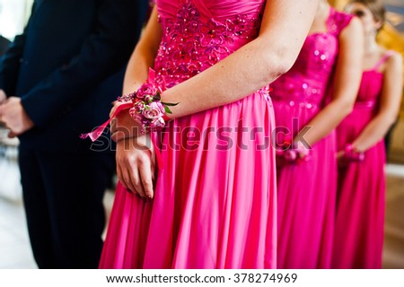 Hands of three bridesmaids in pink dresses - stock photo