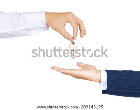 Hands of two businessman, giving and taking modern key, isolated over white background - stock photo