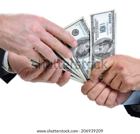Hands of two businessmen giving and taking dollars - stock photo
