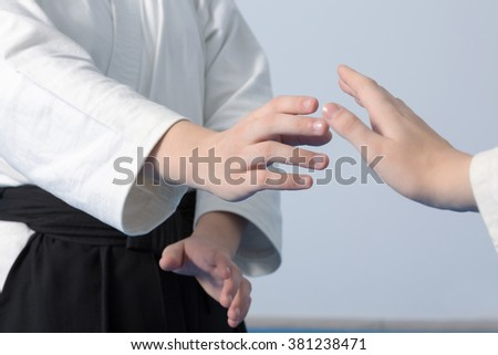 Hands of two girls standing in stance on martial arts training