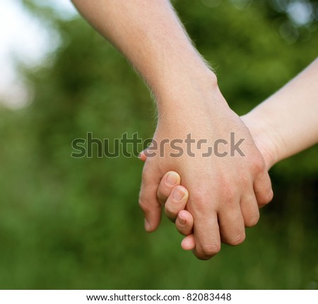 hands of two lovers - stock photo