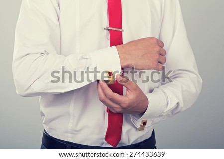 Hands of wedding groom getting ready in suit, vintage style effect picture - stock photo