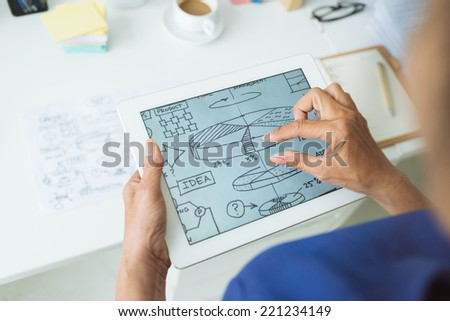 Hands of woman examining infographic on the digital tablet - stock photo