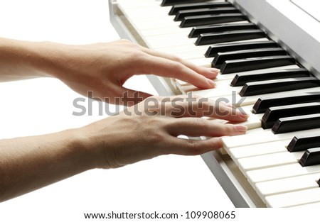 hands of woman playing synthesizer - stock photo