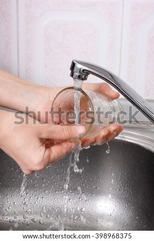 hands of woman washing the glass