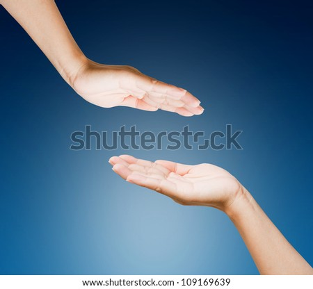 Hands of women isolated on blue background