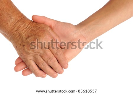 Hands of young and senior women - helping hand concept - clipping path included - stock photo