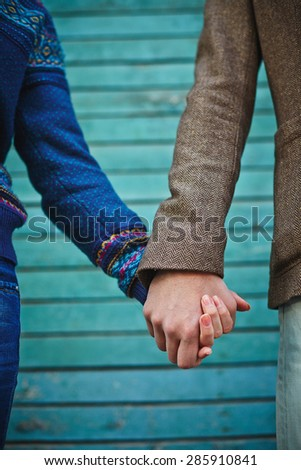 Hands of young couple in casualwear - stock photo