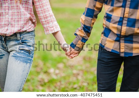 Hands of young people in the nature, team concept. 
