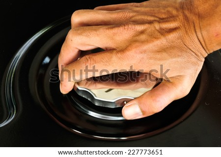 Hands off the engine cover, fuel tank.  - stock photo