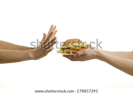 Hands offering a big hamburger and hungry hands ready to deny,isolated on white - stock photo