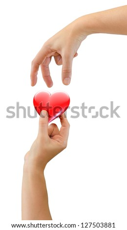 Hands offering and receiving loving heart symbol - isolated on white - stock photo