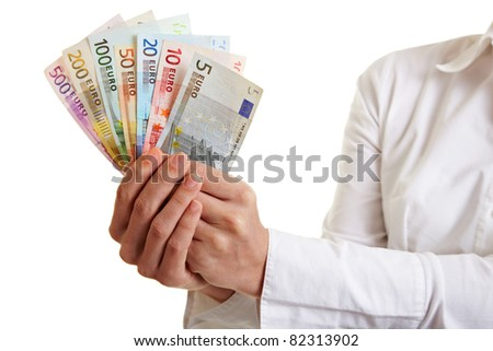 Hands offering fan of Euro money bills - stock photo