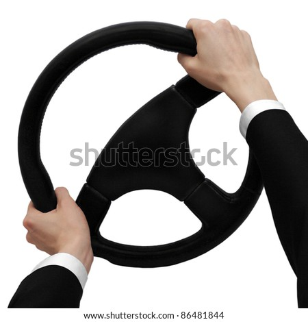 Hands on a steering wheel turn to the left isolated on a white background - stock photo