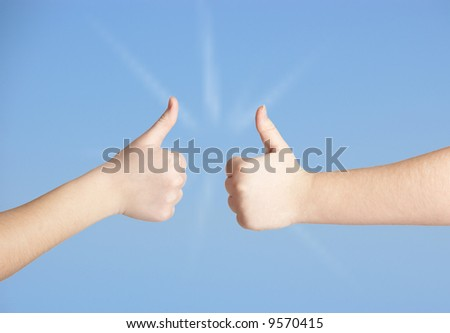 Hands on blue sky background - stock photo
