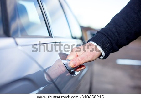 Hands On Car Door