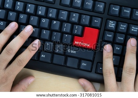 "Hands on computer keyboard with ""Network"" word at enter button. - stock photo"