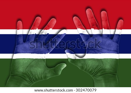 hands on Gambia flag background - stock photo