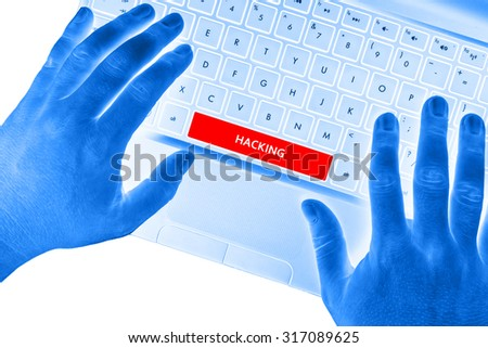 "Hands on laptop with ""HACKING"" word on spacebar button on white background."