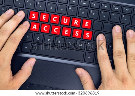 """Hands on laptop with """"SECURE ACCESS"""" words on keyboard buttons. - stock photo"""