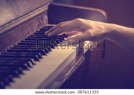 hands on the key of the piano,cool tone - stock photo