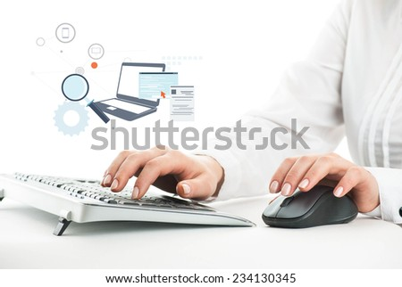 Hands on the keyboards and on the mouse with added graphic icon - stock photo