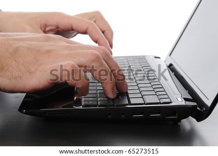 Hands on the laptop keyboard.
