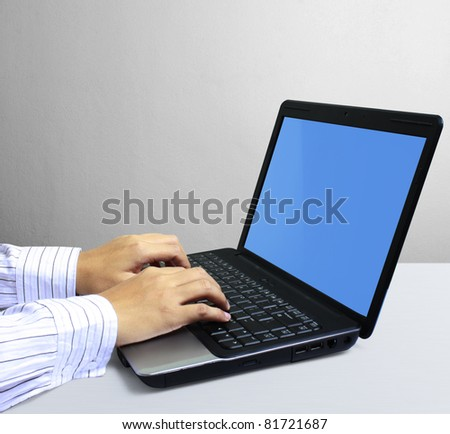 hands on the laptop keyboard - stock photo
