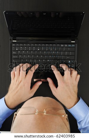 Hands on the laptop keyboard. Isolated on white - stock photo