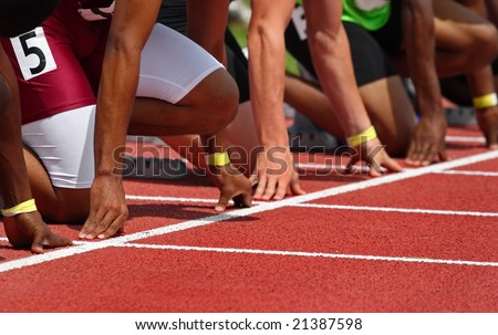 Hands on the starting line (shallow depth of field) - stock photo