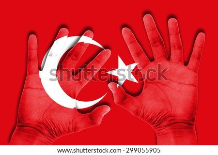 hands on turkey flag background