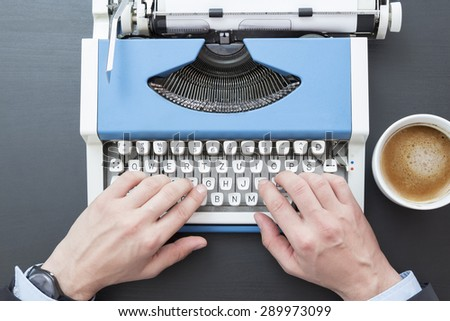 Hands on typing machine  - stock photo