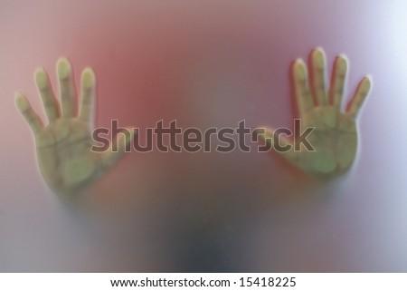 Hands on window - stock photo