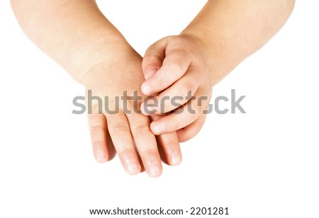 hands ( one upon the other ) of a little girl isolated on white