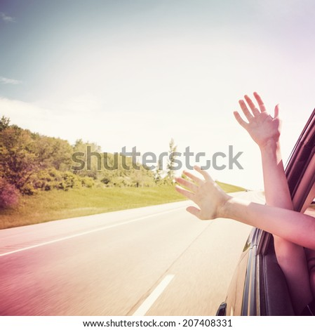 Hands out of car window - stock photo