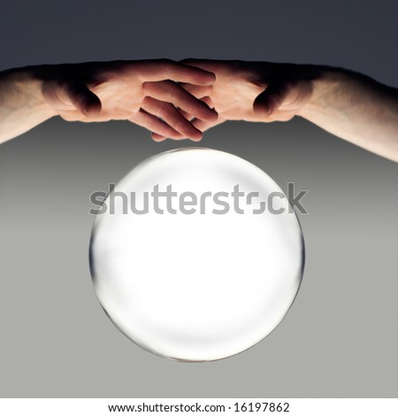 hands over a crystal ball of fortune with a clipping path - stock photo