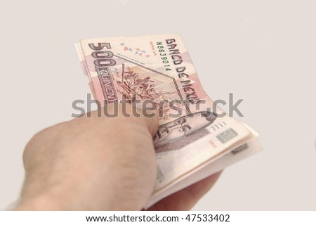 Hands over Mexican pesos - stock photo