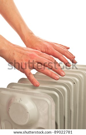 Hands over the heater - stock photo
