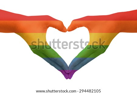 Hands painted as the rainbow flag forming a heart, symbolizing gay love - stock photo