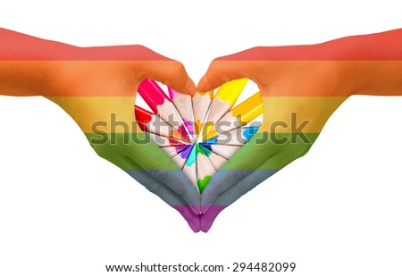 Hands painted as the rainbow flag forming a heart, symbolizing gay love with color pencil. - stock photo