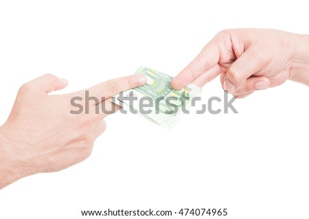 Hands passing euro currency in closeup as bribery concept isolated on white studio background