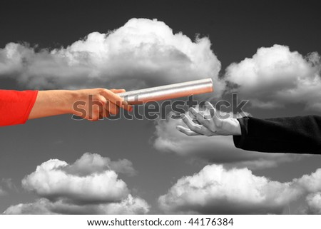hands passing the baton, business and sports theme - stock photo