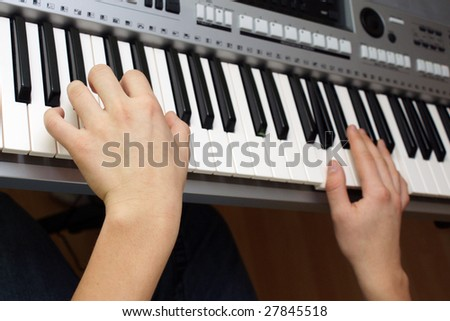 hands playing keyboards