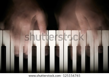Hands playing piano. Motion blur - stock photo