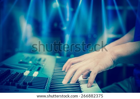 hands playing the keyboard or piano, focus middle finger - stock photo